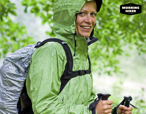Woman hiking in the rain in a forest