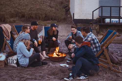 Group of people enjoying fellowship while hiking and camping